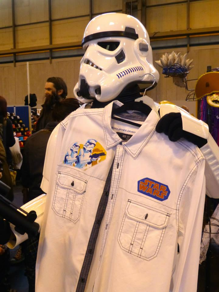 A Storm trooper holding a white denim jacket