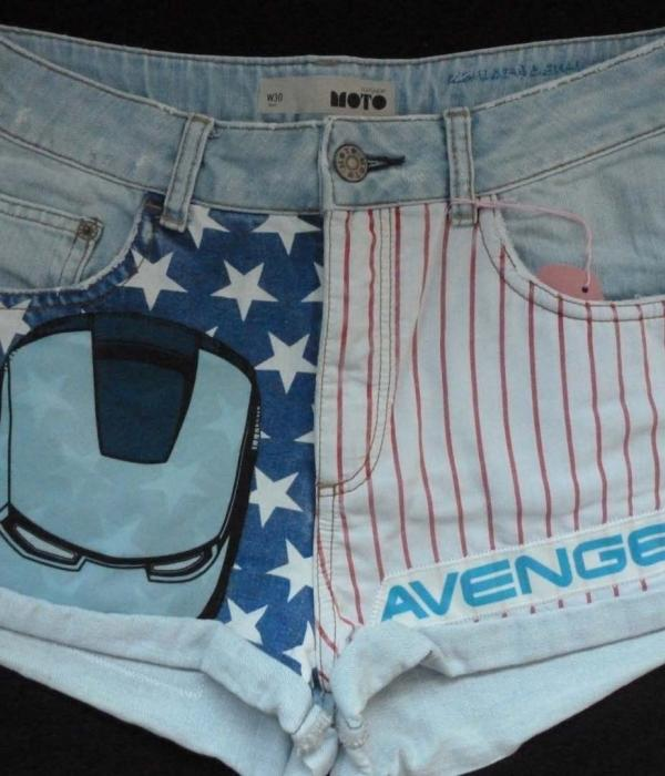 A pair of pale denim shorts with Captain America USA Flag Stars & Stripes themed fabric