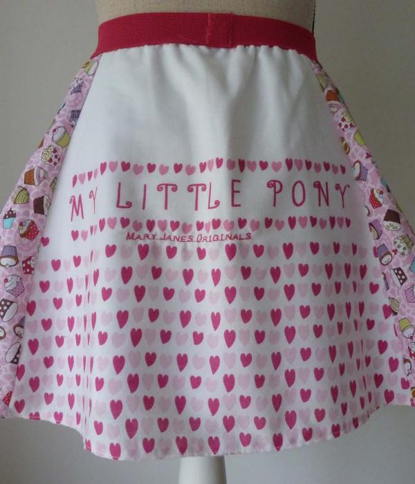 A My Little Pony themed skirt displayed on a mannequin with cupckaes and hearts