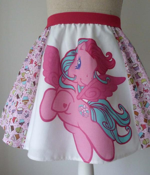 A My Little Pony themed skirt on a mannequin with cupckaes, hearts and a pink horse